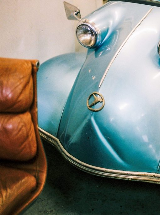 Brown-leather-lounge-and-blue-car-front